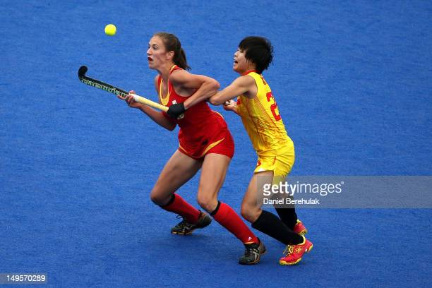 Judith Vandermeiren of Belgium and Xiaoxu Xu of China eye the ball during the Women's Hockey Match between Belgium and China on day 4 of the London...