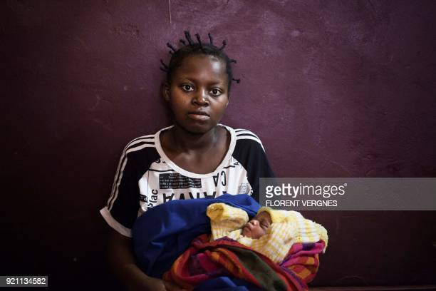 Judith waits on February 14 2018 with her newborn baby for a doctor's visit at Boali maternity ward which has only one doctor and no running water a...