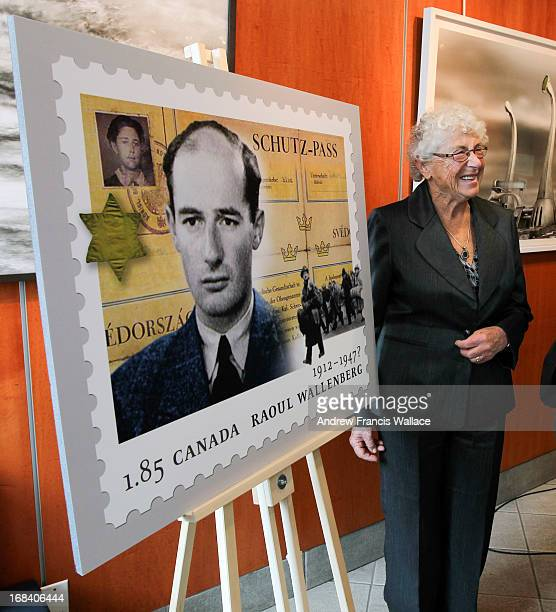 Judith Weiszmann poses in front of a Canada Post Stamp commemorating Raoul Wallenberg at the Miles Nadal Jewish Community Centre The stamp features a...
