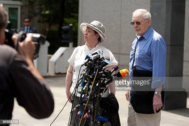 Judith Welling left and Dewitt Baker victims of a Ponzi scheme operated by Bernard Madoff founder of Bernard L Madoff Investment Securities LLC speak...