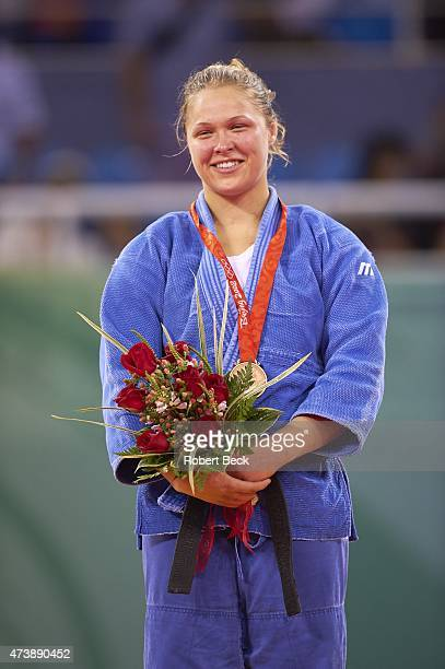 2008 Summer Olympics USA Ronda Rousey victorious with bronze medal on medal stand after winning Women's 70kg Medal Round at Beijing Science and...