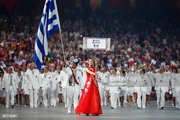 Judo athlete Ilias Iliadis of Greece carries his country's flag during to lead out the delegation during the Opening Ceremony for the 2008 Beijing...