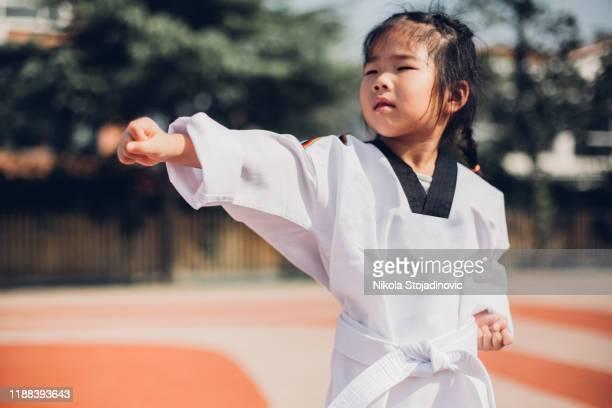 judo girl - obi sash stock pictures, royalty-free photos & images
