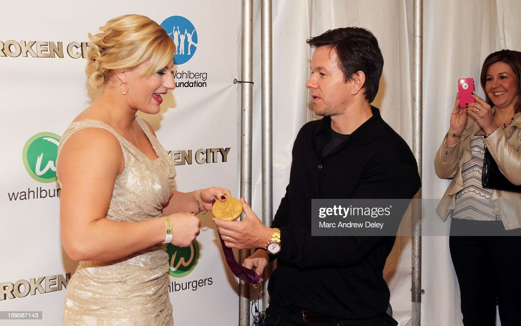 Judo Olympic Gold Medalist Kayla Harrison and Mark Wahlberg share a conversation before the screening of 'Broken City' hosted by Mark Wahlberg at Patriot Cinemas on January 15, 2013 in Hingham, Massachusetts.