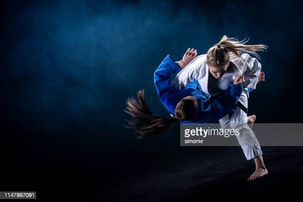 judo players competing in judo match - judo stock pictures, royalty-free photos & images