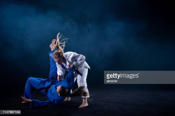 judo players competing in judo match - martial arts stock pictures, royalty-free photos & images