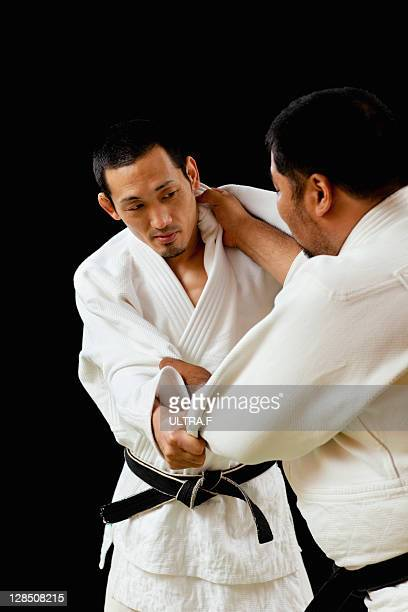 Judo players playing match