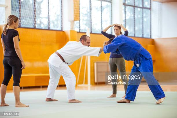 Judo Trainers Teaching Women Self Defense Against Hair Grabbing
