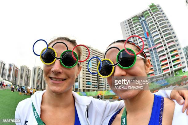 Judoka Marti Malloy and Angelica Delgado pose for a picture at the Athletes' Village ahead of the Rio 2016 Olympic Games in Rio de Janeiro on August...