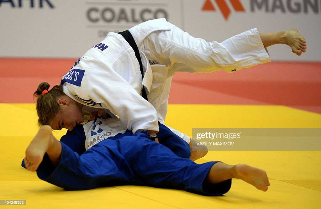 Judoka Sanne Verhagen of the Netherlands (white) competes with Mongolia's Sumiya Dorsjuren during the under 57 kg category competition for bronze medal at the IJF World Judo Championship in Chelyabinsk on August 27, 2014.