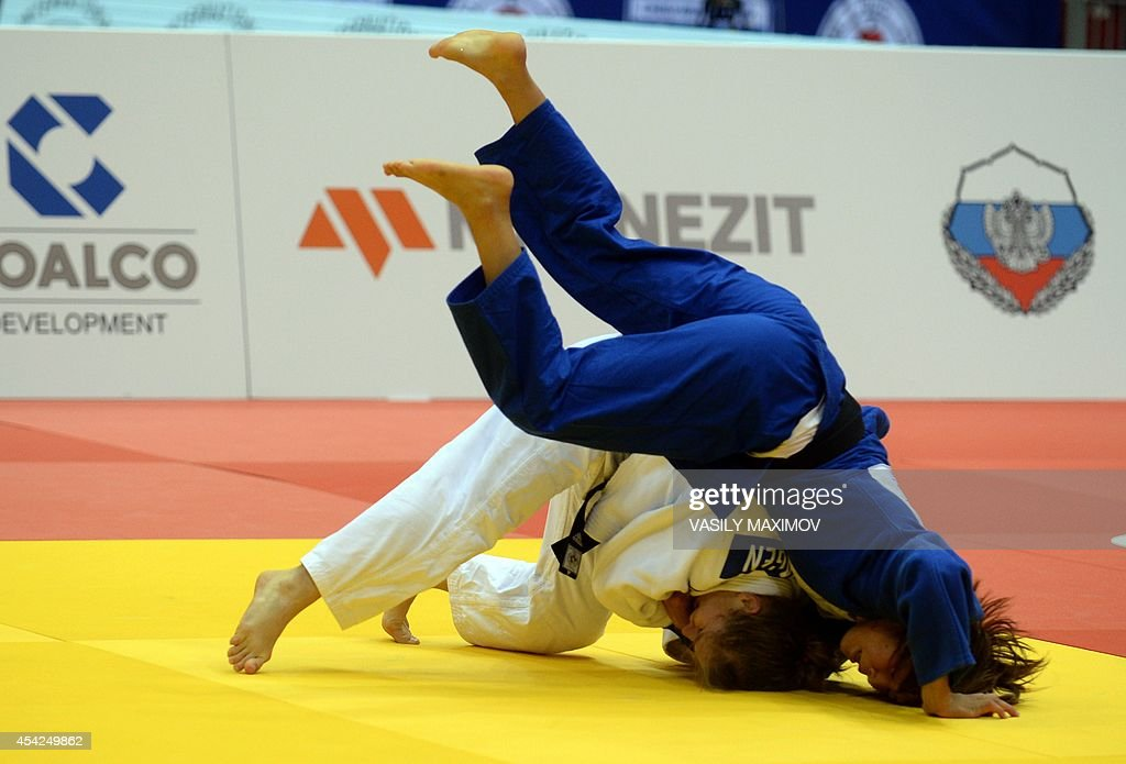 A judoka Sanne Verhagen of the Netherlands (white) competes with Mongolia's Sumiya Dorsjuren during the under 57 kg category competition for bronze medal at the IJF World Judo Championship in Chelyabinsk on August 27, 2014.