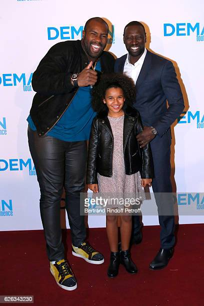 """Judoka Teddy Riner, actors of the movie, Gloria Colston and Omar Sy attend the """"Demain Tout Commence"""" Paris Premiere at Cinema Le Grand Rex on..."""
