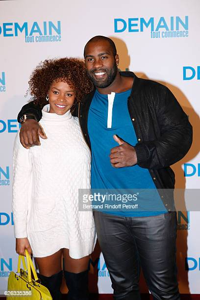 """Judoka Teddy Riner and his wife Luhtna Plocus attend the """"Demain Tout Commence"""" Paris Premiere at Cinema Le Grand Rex on November 28, 2016 in Paris,..."""
