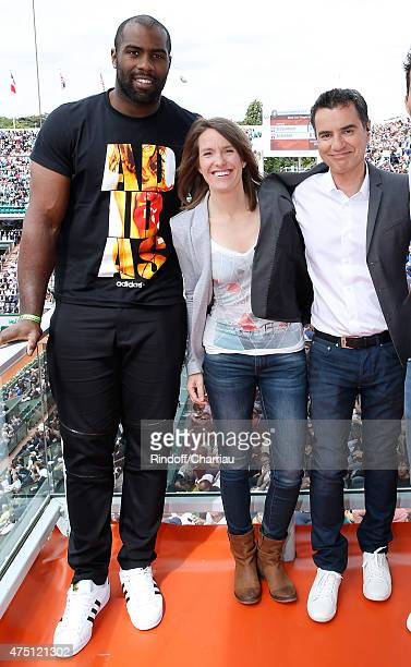 Judoka Teddy Riner Former Tenis player Justine Henin and Sports journalist Laurent Luyat pose at France Television french chanel studio during the...