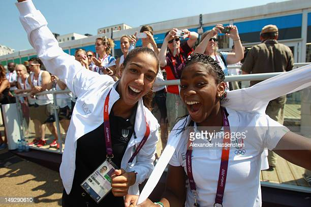 Judokas Giulia Quintavalle and Edwige Gwend of Italy arrive during the Olympic Village arrivals ahead of the London 2012 Olympics at the Olympic Park...
