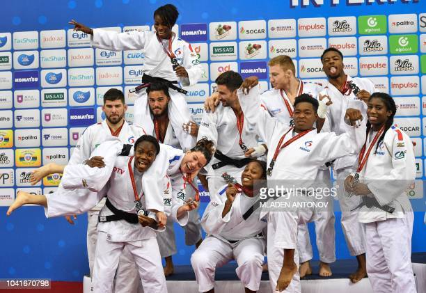 Judokas of the French team pose with their silver medals during the podium ceremony for the mixed team event of the 2018 Judo World Championships in...