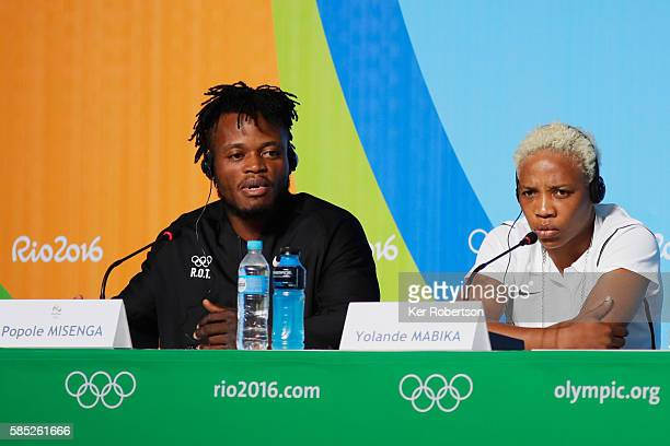 Judokas Popole Misenga and Yolande Mabika from the Democratic Republic of the Congo talk while attending a press conference given by the Olympic...