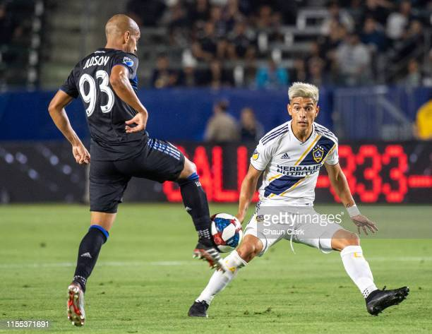 Judson of San Jose Earthquakes battles Favio Alvarez of Los Angeles Galaxy during the Los Angeles Galaxy's MLS match against San Jose Earthquakes at...