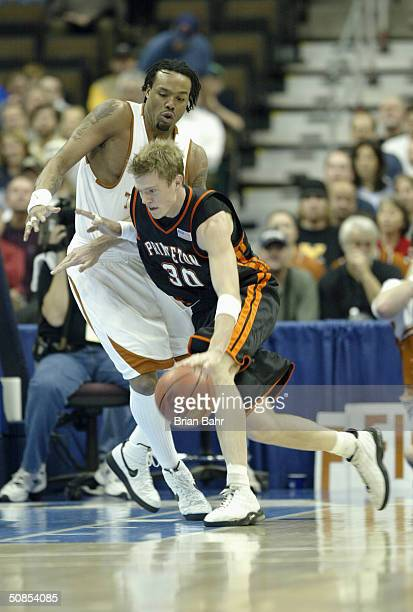 Judson Wallace of the Princeton Tigers drives against a Texas Longhorns defender during a first round game in the NCAA Men's Basketball Tournament at...