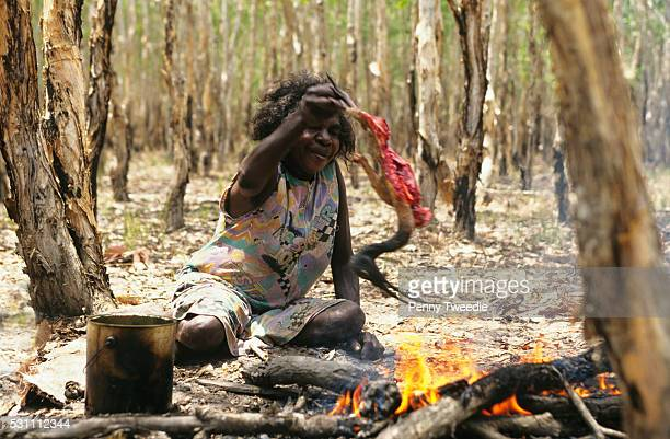 Judy Baypungnala cooks an ibis caught while hunting and gathering in her clan country in central Arnhem land Judy is a very traditional woman she is...