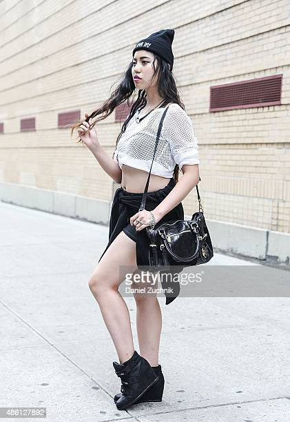 Judy C Yang is seen in Soho wearing an Express top Forever 21 hoodie shoes and necklace with a Michael Kors bag on August 31 2015 in New York City