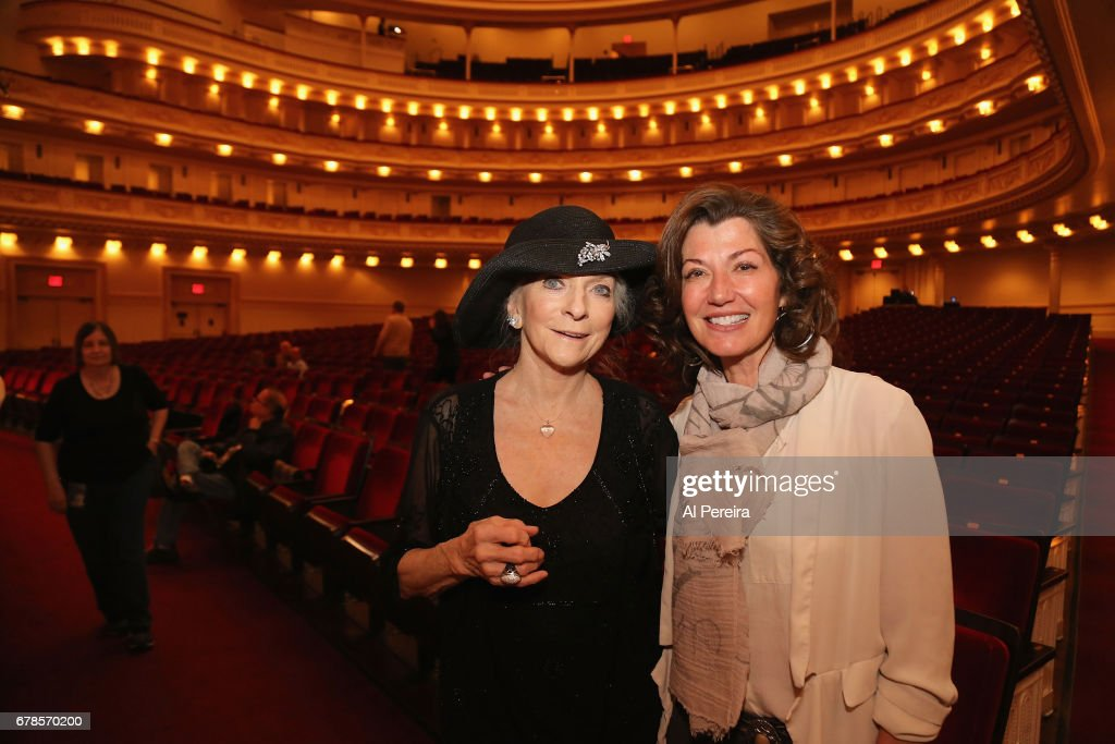 Judy Collins and Amy Grant chat during 'City Winery Presents A Celebration of the Music of Jimmy Webb' at Carnegie Hall on May 3, 2017 in New York City.