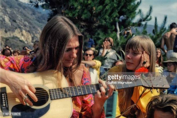 """Judy Collins and Joni Mitchell """"back stage"""" , Judy playing her guitar, and Joni with chin in hand, listening. Big Sur Hot Springs, later Escalen..."""