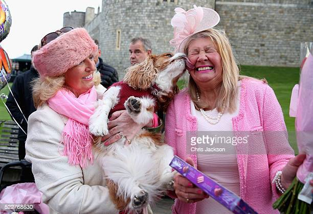 Judy Daley and Anne Daley from Cardiff wait in position for the Queen's 90th Birthday Walkabout on April 21 2016 in Windsor England Today is Queen...