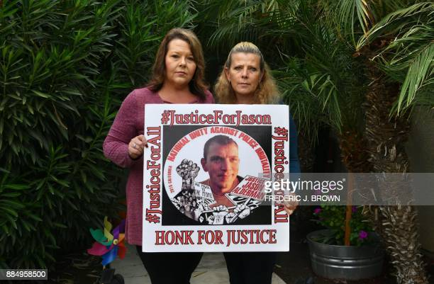 Judy Edens and Tracy Alderman mother and aunt hold a portrait of Judy's son Jason Alderman on November 17 2017 in Bakersfield Kern County California...