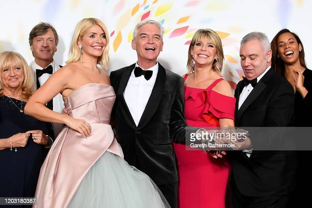 Judy Finnigan Richard Madeley Holly Willoughby Phillip Schofield Ruth Langsford Eamonn Holmes Rochelle Humes of This Morning pose in the winners room...