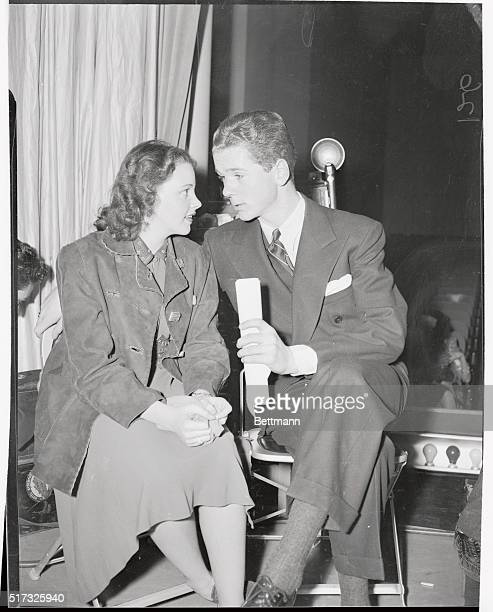 Judy Garland and Jackie Cooper take a little time out during rehearsal of the American Calling program here. It was a broadcast coast to coast the...