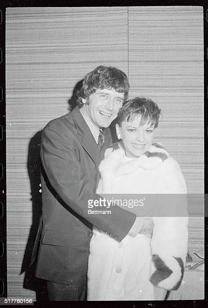 Judy Garland and Mickey Deans a musician and manager of a discotheque share a moment together while in New York for a television appearance December...