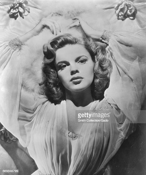 Judy Garland in a seductive pose viewed from above on a bed 1945