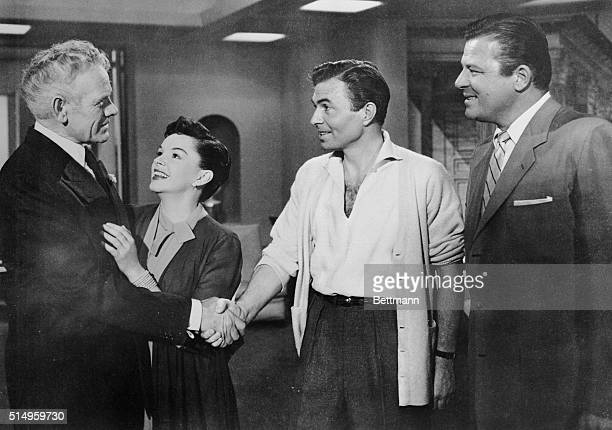 Judy Garland, Janus Mason, and Jack Carson in Warner Brothers' A Star is Born, directed by George Cukor.