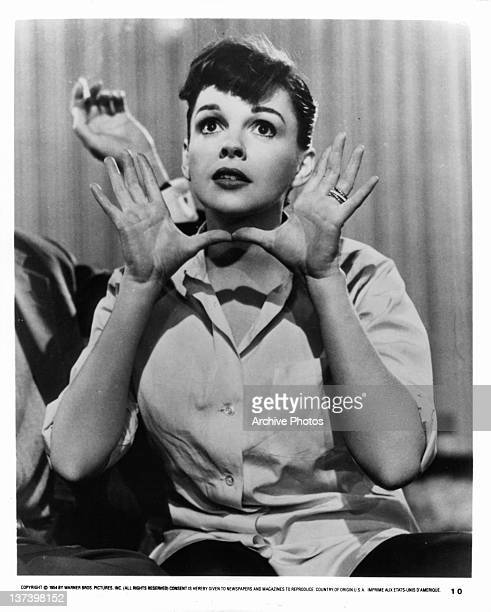Judy Garland makes hand gesture in a scene from the film 'A Star Is Born', 1954.