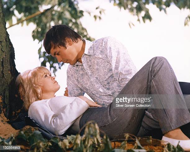 Judy Geeson British actresss laying at the foot of a tree with Barry Evans British actor in a publicity still issued for the film 'Here We Go Round...