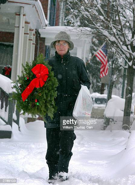 Judy Gleason walks home in the snow after purchasing a Christmas wreath December 6 2003 in Lambertville New Jersey This town of specialty boutique...