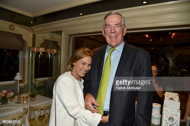 Judy Gordon Cox and Archie Cox attend the launch of Second Bloom Cathy Graham's Art of the Table hosted by Joanna Coles and Clinton Smith at Bergdorf...