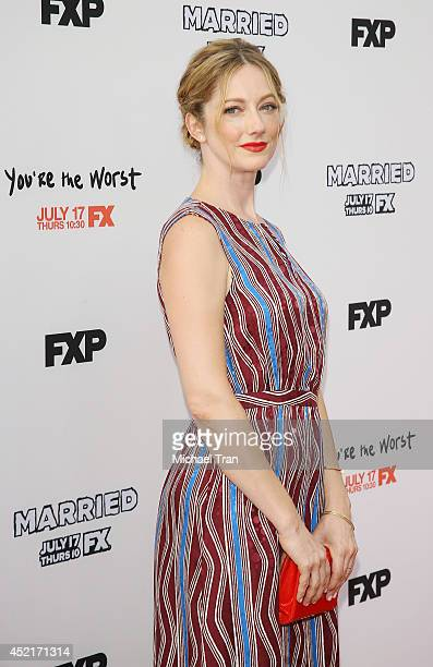 Judy Greer arrives at the Los Angeles premieres of You're The Worst and Married held at Paramount Studios on July 14 2014 in Hollywood California