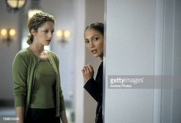 Judy Greer watches as Jennifer Lopez hides in a scene from the film 'The Wedding Planner' 2001