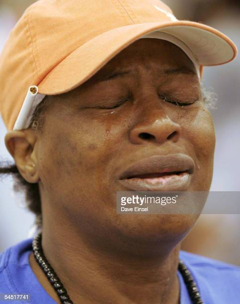 Judy Grimes of New Orleans Louisiana cries as she pleads for help to find lost family members in the Reliant Center which is located near the...