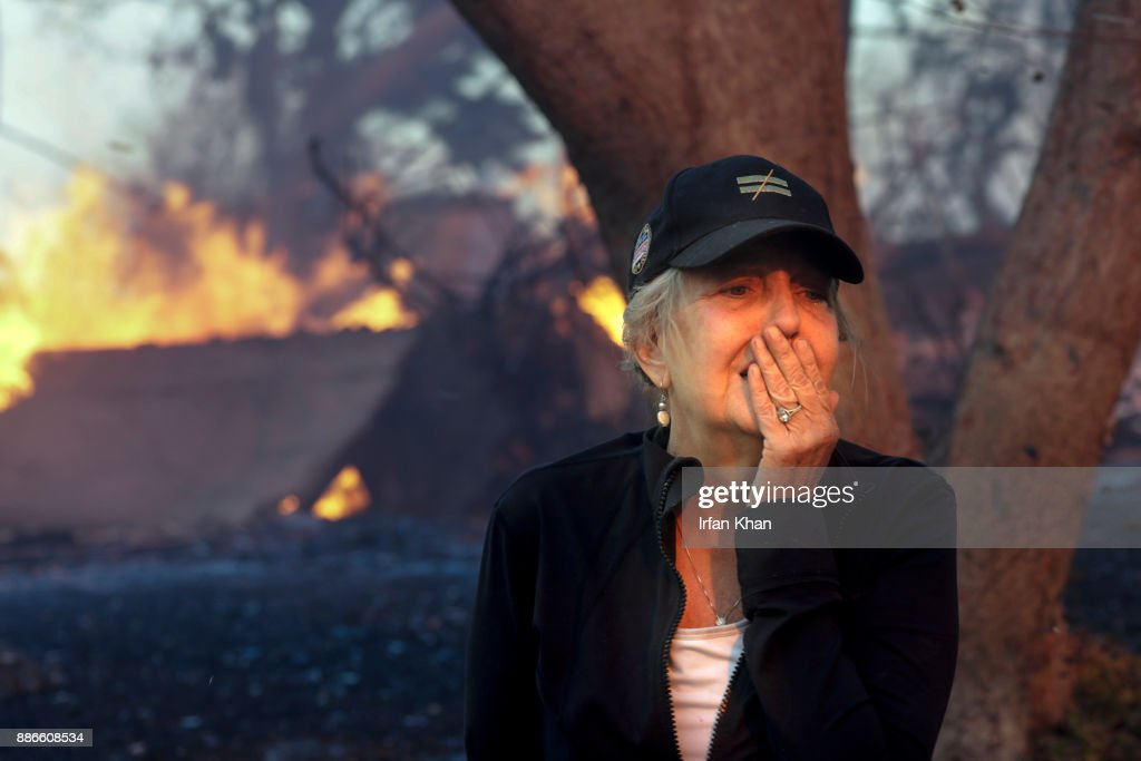 DECEMBER 05, 2017 -- Judy Hofmann-Sanders can only watch as her home is consumed by the Creek fire along McBroom Street in Shadow Hills.