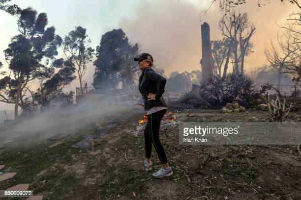 Judy HofmannSanders survey's the area after her home was consumed by the Creek fire along McBroom Street in Shadow Hills