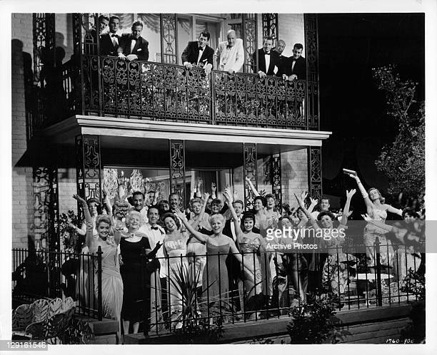 Judy Holliday and a bevy of beauties cavort in a scene from the film 'Bells Are Ringing' 1960