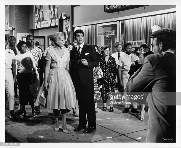 Judy Holliday and Dean Martin find themselves in the middle of Times Square in a scene from the film 'Bells Are Ringing' 1960