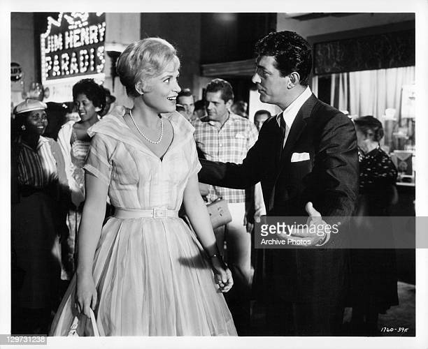 Judy Holliday and Dean Martin meet in New York in a scene from the film 'Bells Are Ringing' 1960