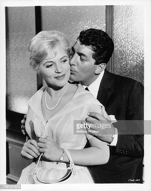 Judy Holliday is kissed by Dean Martin in a scene from the film 'Bells Are Ringing' 1960