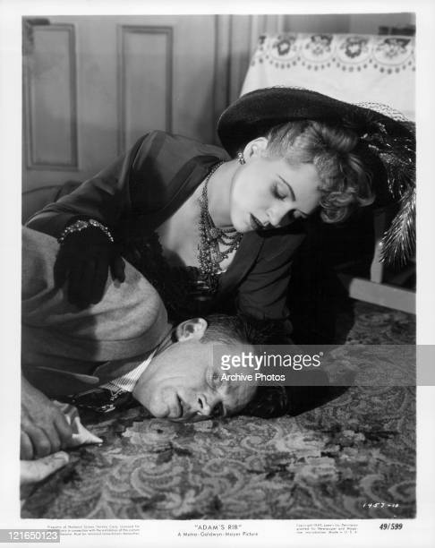 Judy Holliday looking over Tom Ewell in a scene from the film 'Adam's Rib' 1949