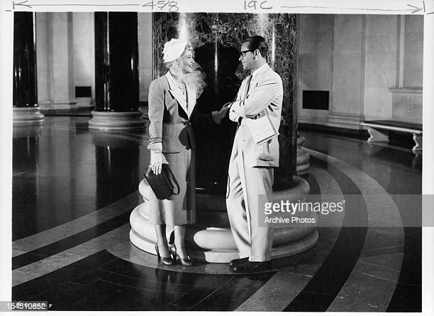 Judy Holliday speaks to William Holden in a scene from the film 'Born Yesterday' 1950