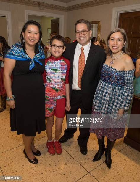 Judy Kevin and Harold Sanders and designer Marisol Deluna attend the Marisol Deluna Foundation Community Fashion Show at the San Antonio Garden...